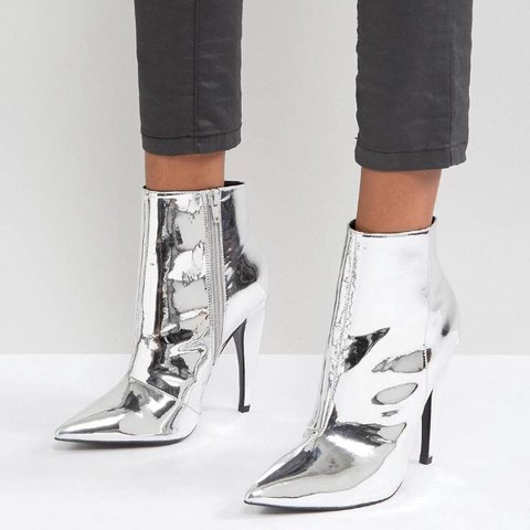 50e81c1ade93 Silver Shiny Pointed Ankle Boots - Size 6. These are brand - Depop