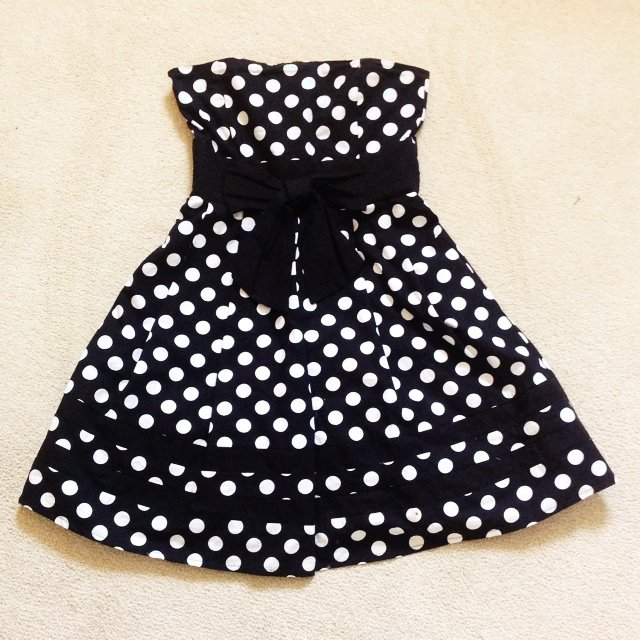 Black strapless dress with white spots and