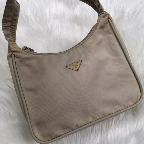 c181611312a38f @newbornhippy. 7 months ago. United States. Authentic vintage Prada nylon  purse!