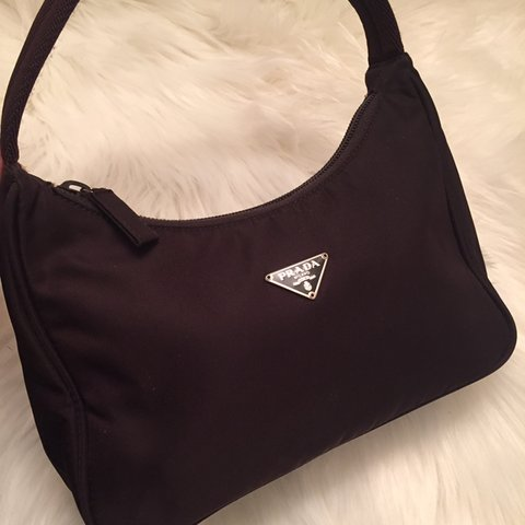 d4acbc792235ae @newbornhippy. 6 months ago. United States. Authentic vintage Prada mini nylon  bag.