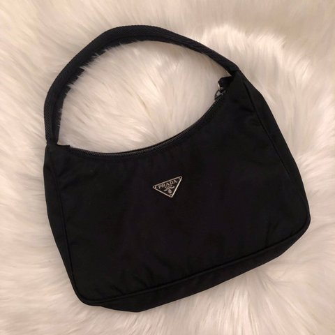 d7a6f09cf0f51b @newbornhippy. 5 months ago. United States. Authentic vintage Prada mini  nylon pochette black hand bag.