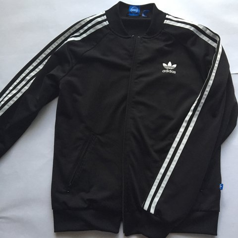02957737970d Adidas black jacket. Kids size large. Fits if you wear small - Depop