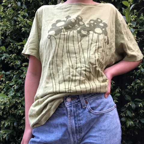 6d5d9704 Super cute over sized marimekko t shirt with flower Fits on - Depop