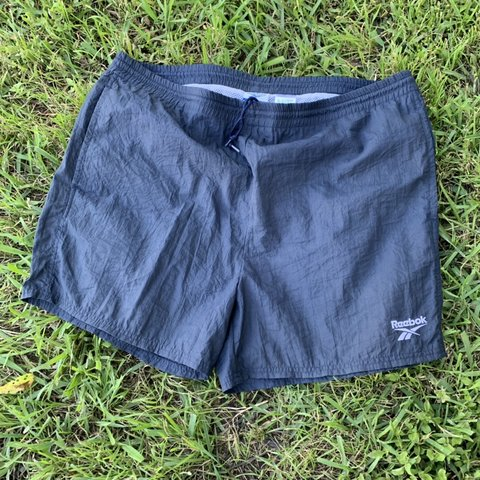 fc0170dc5a Vintage Reebok swim trunks with pockets and netting. Fit of - Depop