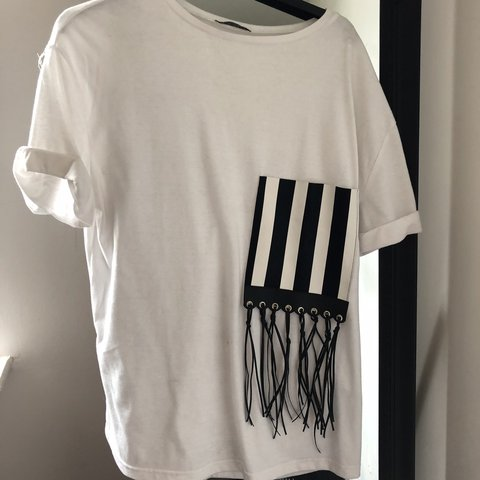 980adc9f @ejl01. 9 months ago. Stockton-on-Tees, United Kingdom. Zara white  oversized tshirt with black and white monochrome stripe fringe pocket  detail. Size small ...
