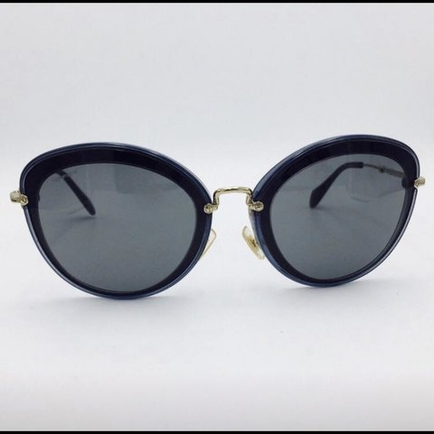 95eb8dc65 @shaunawillo. 20 days ago. Newmarket, Canada. Authentic Miu Miu sunglasses  in navy blue with grey lenses.