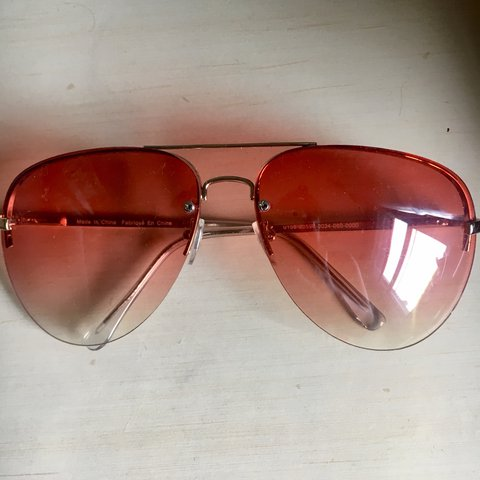 dab33e47b8  erinjanewood. last month. United States. Pink tinted sunglasses from urban  outfitters