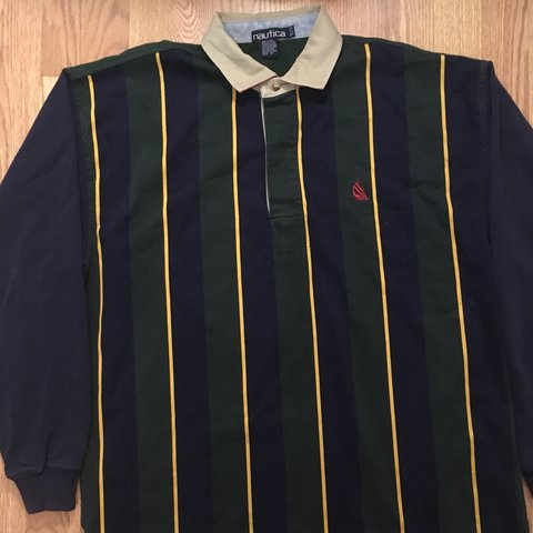 87a3bae1 @nostalgianetwork. 7 months ago. San Marcos, United States. Vintage Nautica  striped rugby long sleeve polo shirt.