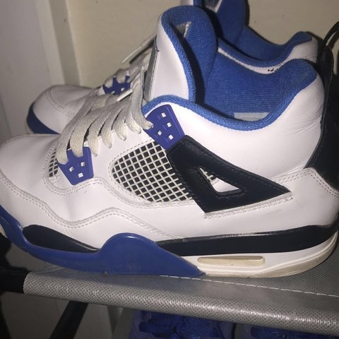 08fafd663f1830 jordan 4 s blue and white and black. size 4.5y - Depop