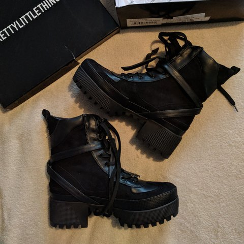 fbf941bc339 Karmel black biker boots - Featuring faux leather wrap and a - Depop