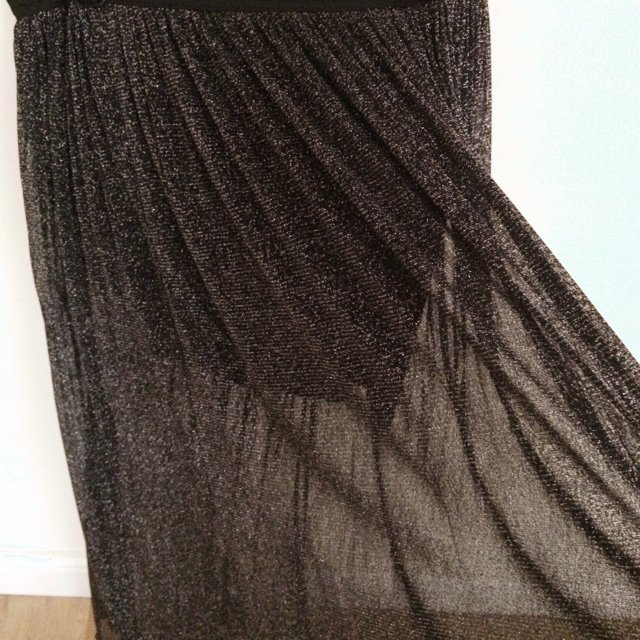9bf19a964258 @bridietyler. 5 years ago. London, United Kingdom. Long black sparkly skirt  see through ...