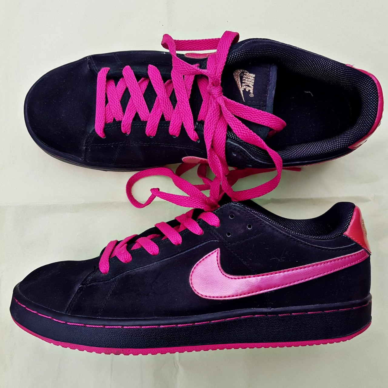 black and pink Nike trainers in Size UK