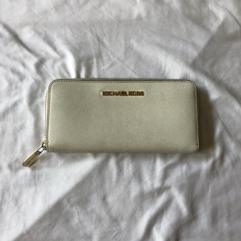 8c21bed1b1d6 Moderately used Michael Kors wallet/clutch. Off white when - Depop