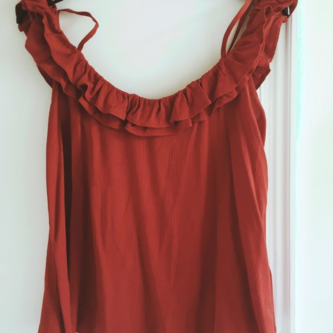 26a9d049fdf4d2 Topshop size 10 burnt orange cold shoulder top. Only worn as - Depop