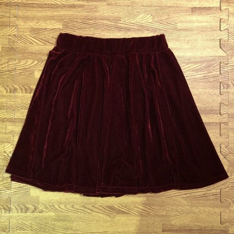 735911cad5 Red velvet skirt. Elastic waist band, one size , can fits is - Depop