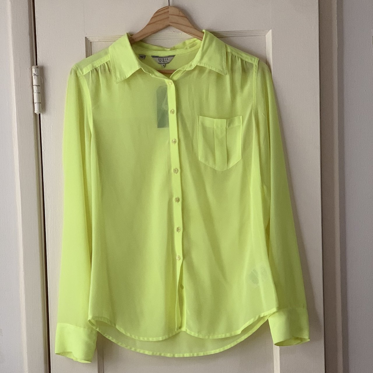 7b0def2b8 Guess neon yellow sheer chiffon button down blouse. Never on - Depop