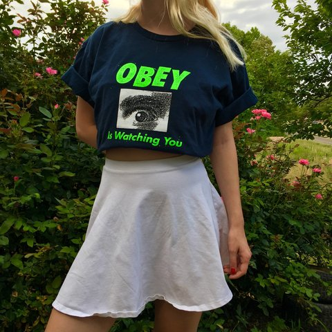 7fe596131 Obey is watching you neon green and navy blue T-shirt (cute - Depop