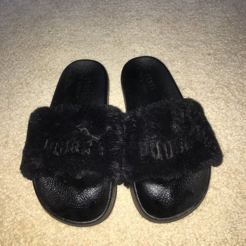 d439215e214f BLACK FLUFFY PUMA SLIDES Selling for  18 negotiable only a - Depop