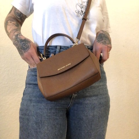 f8f7b19a041e @amphimandaalso. 2 months ago. Carlsbad, United States. Michael Kors Ava  extra-small brown crossbody, top-handle bag. Tiny and so cute!!