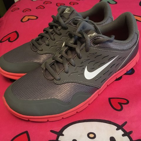 4dd2b7b5bde42 Women s Nike running shoe. Size 8 Coral and grey. Very good - Depop