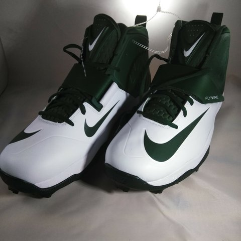 769c3ff69 Brand new Nike cleats for baseball green and white and has a - Depop