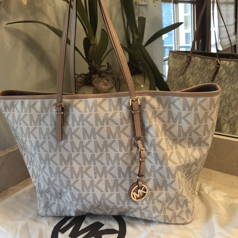 5a856130541b @taylorbarnetttt1. 6 months ago. Hobe Sound, United States. Michael Kors. Authentic  genuine large jet set tote ...
