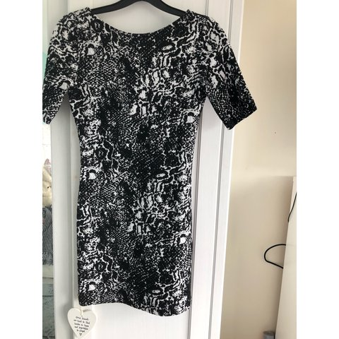 8d38995662ac @nicolegrenfell. last year. Gateshead, United Kingdom. Size 8 H&M black and  white patterned dress with low cut ...