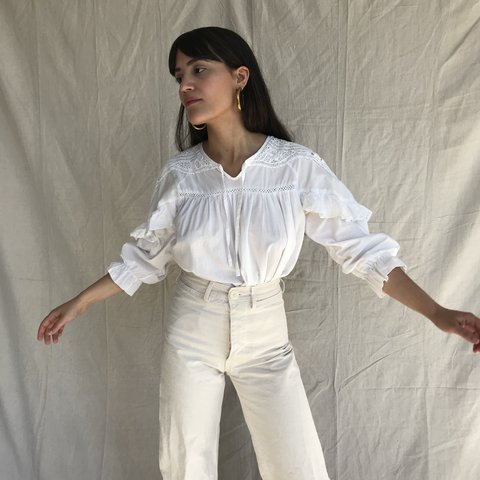 207a001acec6 White cotton ruffled peasant blouse. Loose fitting. Looks a - Depop
