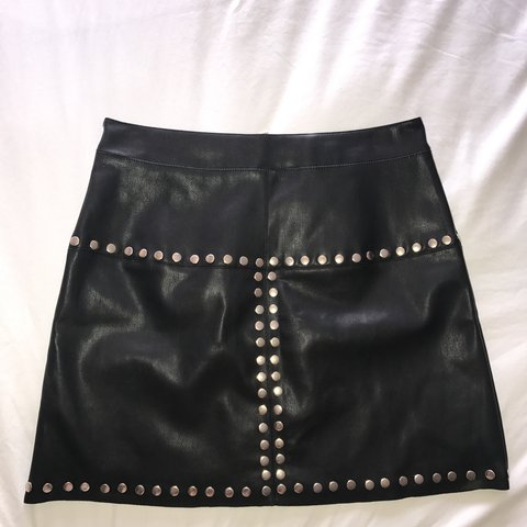 5db417411a @beckytysoexx. 2 years ago. Dartford, United Kingdom. Black faux leather mini  skirt with gold stud detail