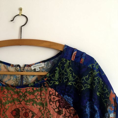 842f7efd3abfb1 River Island Top • Size 14 • Orange and Blue patterned top a - Depop