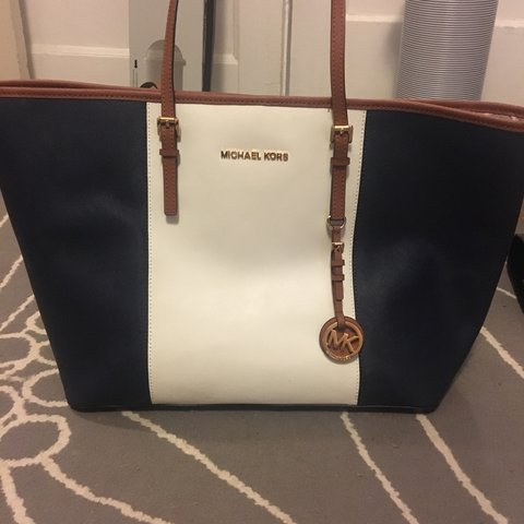 6493efb97bd6 @mikayla5597. last year. Pullman, United States. Navy blue and white  Michael Kors purse!