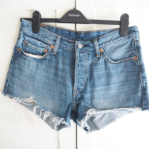 22bbf62c @lynnsaymartin. 2 years ago. Glasgow, UK. Levi's 501 denim shorts with frayed  hem.