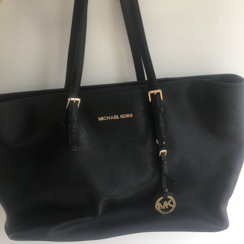 da8981a26195 @lanaparker. 4 months ago. London, United Kingdom. Jet set travel Tote black.  OPEN TO OFFERS Large black Michael Kors bag with gold ...