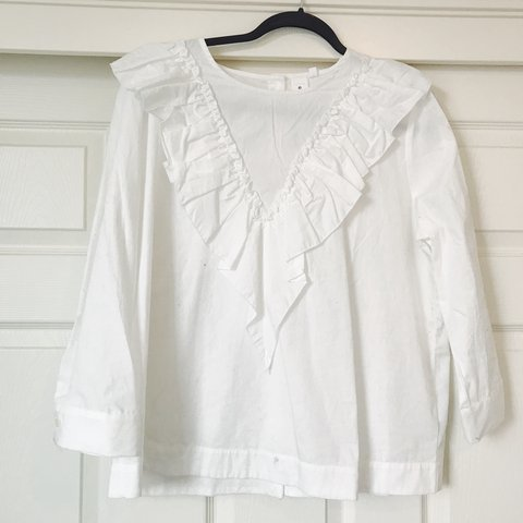 54a3d78dc4ea69 chic white Guest Editor designer blouse with ruffled collar. - Depop
