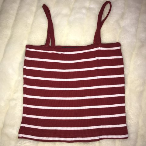 56302f1929e @ryliexe. last month. United States. Brandy Melville Faye cropped tank top.  Red and white stripes.