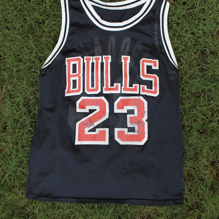 official photos 9fe9a 58640 Vintage Micheal Jordan Jersey black and red slight... - Depop