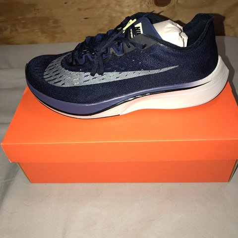 c717591992c6 Nike Zoom Vaporfly 4% Size 10!! Zoom Vaporfly 4% features a - Depop