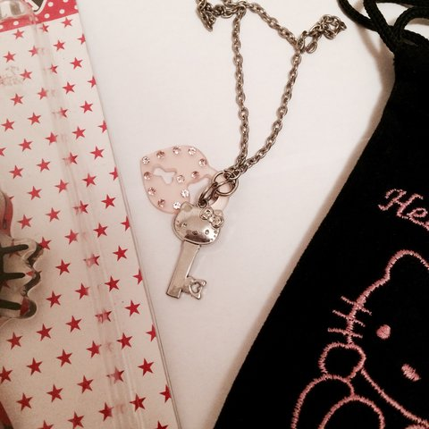 fa50331c1 @xitsmine. 2 years ago. London, UK. Hello kitty silver necklace in small  pouch ...