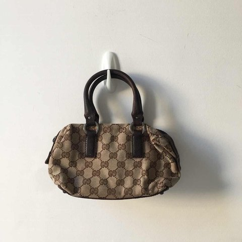 615e2a8d68828c Adorable Y2K Gucci monogram mini bag with leather handles. e - Depop