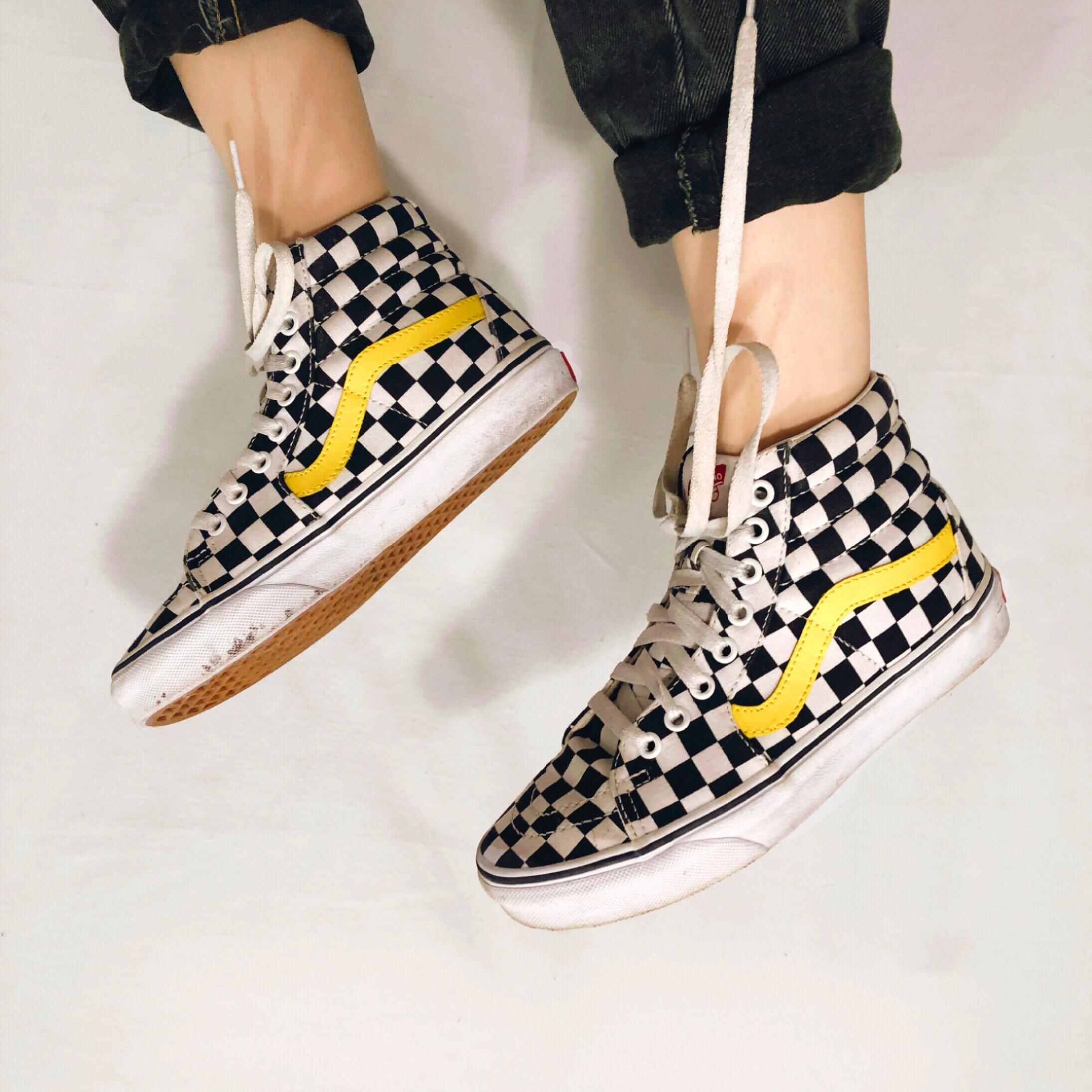 black and white checkered vans with yellow stripe