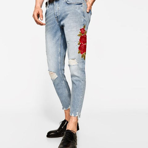 8d4237d2eb0d1a Zara Man ripped denim jeans with rose embroidery on the leg. - Depop