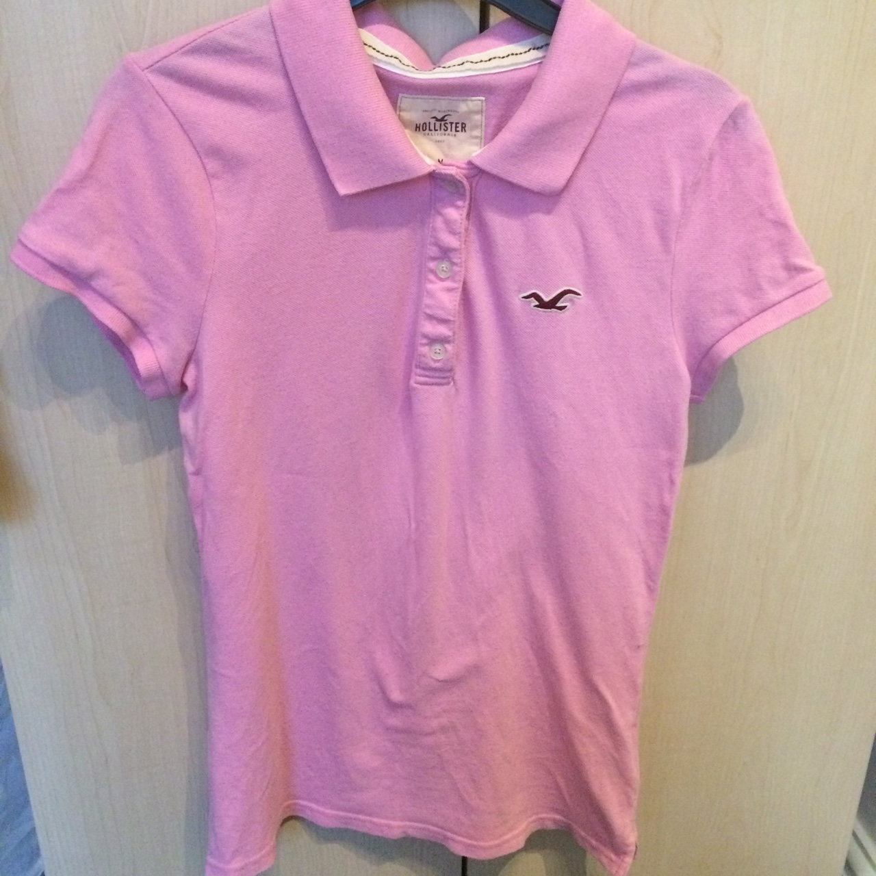be51801e Women's pink Hollister polo - icon on left chest and side - - Depop