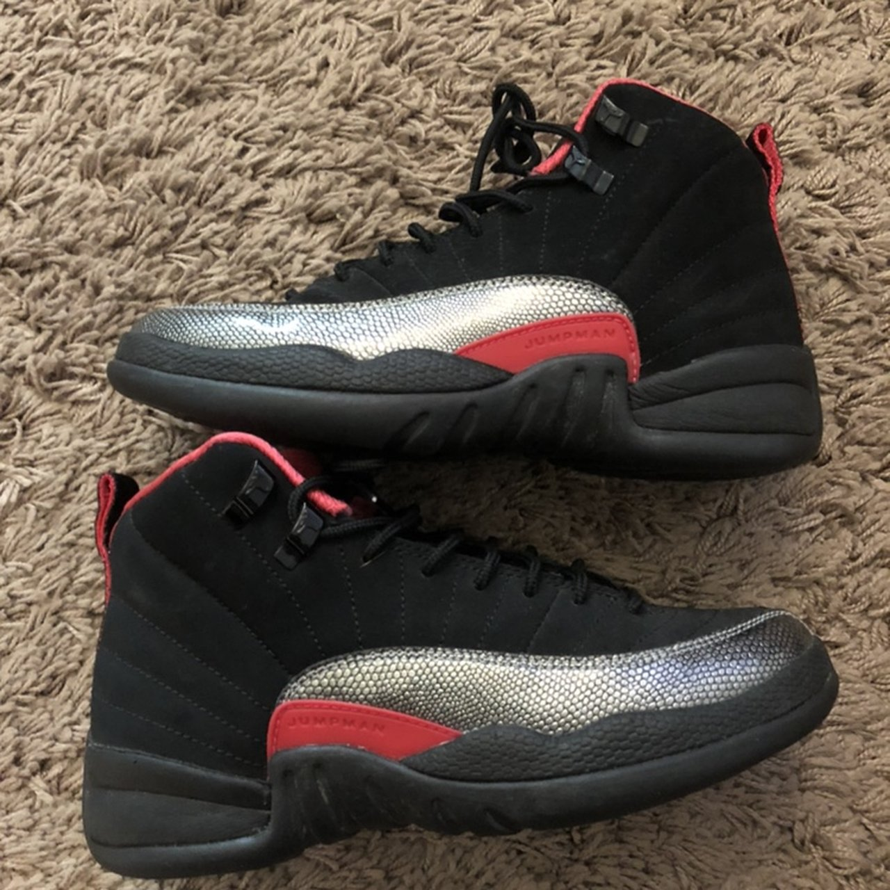 Women s Retro Jordan 12 s black with hot pink size 4 youth - Depop 315c5ef70