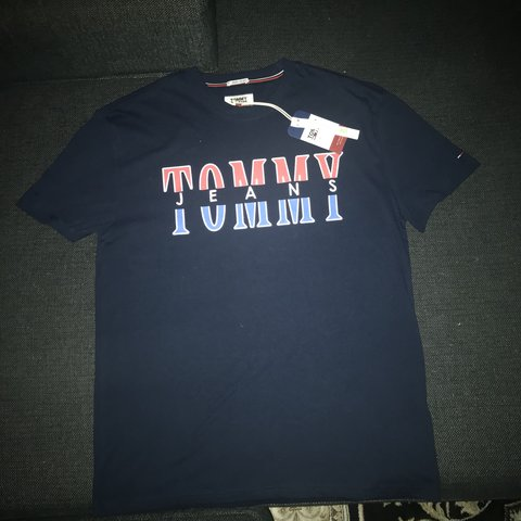 73b28cce Tommy jeans vintage style t-shirt. Tommy part of the text is - Depop
