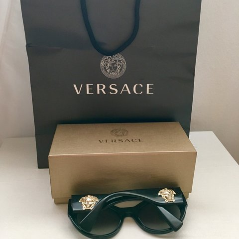 b589fbc0f58d @flow3rchild. 6 months ago. Nottingham, United Kingdom. Versace black cat  eye sunglasses with gold medusa head on the side ...