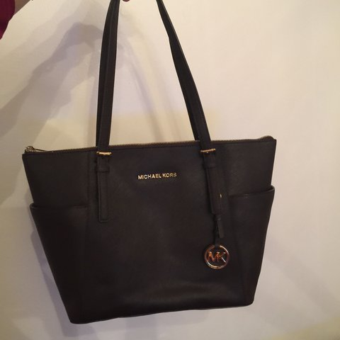 53f4fb5706a257 @mimi_aulaqi. 3 years ago. Connecticut, USA. Dark brown Michael Kors tote  with gold accents. Perfect condition!!