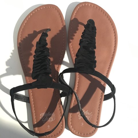 4026c727c Cute brown and black sandals with ruffle design. Barely 9 - Depop