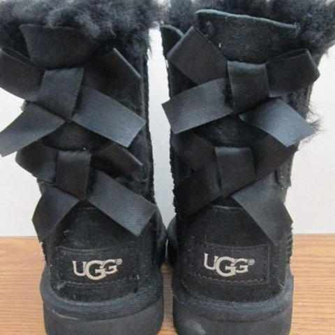 cab523082e74 TODDLER GIRLS SIZE 7 black Ugg boots. Boots have bow tie in - Depop