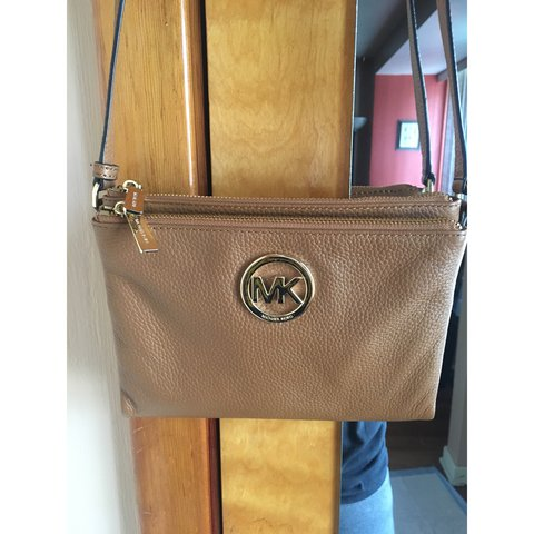 1ec3f57121a8 @heytherepaola. 5 months ago. Chicago, United States. Michael Kors light  brown crossbody bag.