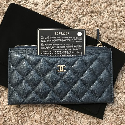 941479f6e81c @jchen815. last year. Diamond Bar, United States. CHANEL Navy blue shimmery  iridescent caviar long flat wallet pouch ...